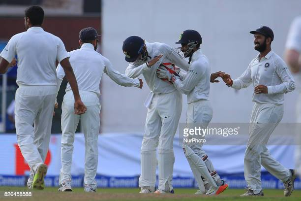 Indian cricketer Lokesh Rahul celebrates with his team mates after Sri Lankan cricketer Upul Tharanga was dismissed during the 2nd Day's play in the...