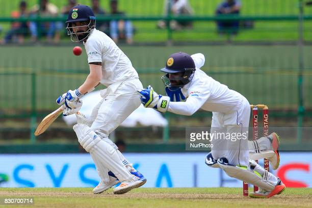 Indian cricketer Lokesh Rahul looks on as Sri Lankan wicket keeper Niroshan Dickwella fails to collect the ball during the 1st Day's play in the 2nd...