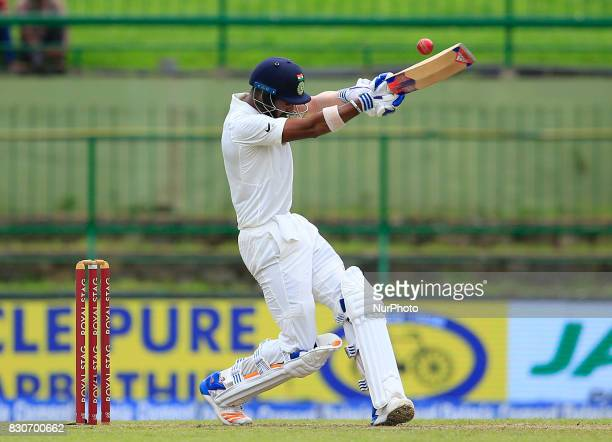 Indian cricketer Lokesh Rahul plays a shot during the 1st Day's play in the 3rd Test match between Sri Lanka and India at the Pallekele International...