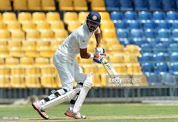 Indian cricketer Lokesh Rahul plays a shot during the first day of the threeday warmup match between Sri Lanka Board President's XI and India at the...