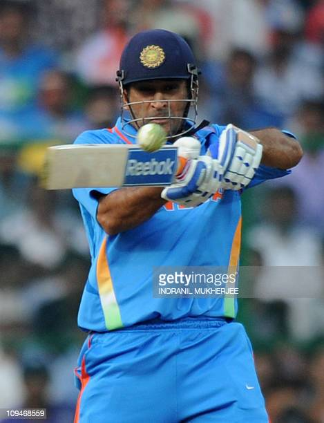 Indian cricketer Mahendra Singh Dhoni plays a shot during the ICC Cricket World Cup 2011 match between England and India at The M Chinnaswamy Stadium...