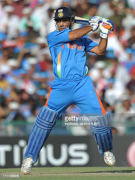 Indian cricketer Mahendra Singh Dhoni plays a shot during the ICC Cricket World Cup semifinal match between India and Pakistan at The Punjab Cricket...