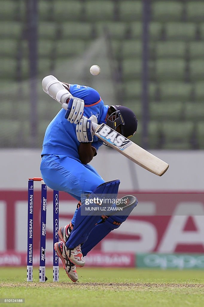 Indian cricketer Mahipal Lomror ducks during the under-19s World Cup cricket final between India and West Indies at the Sher-e-Bangla National Cricket Stadium in Dhaka on February 14, 2016. AFP PHOTO/Munir uz ZAMAN / AFP / MUNIR UZ ZAMAN