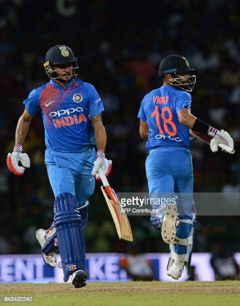 Indian cricketer Manish Pandey and captain Virat Kohli run between the wicket during the Twenty20 international cricket match between Sri Lanka and...