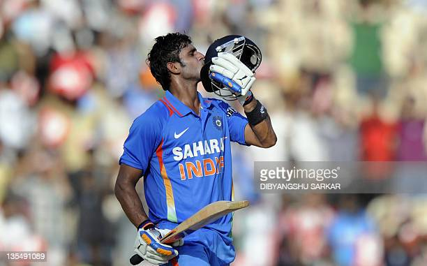 Indian cricketer Manoj Tiwary celebrate after scoring a halfcentury during the final One Day International match between India and West Indies at The...