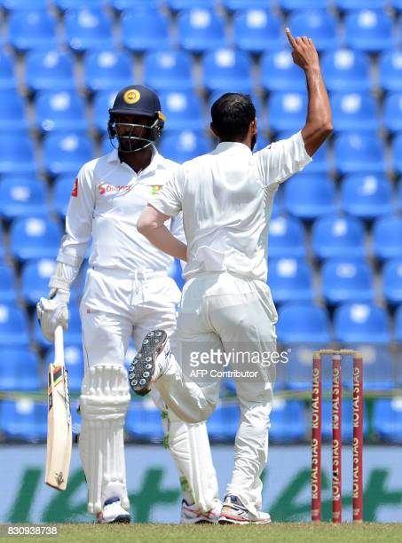 Indian cricketer Mohammed Shami celebrates after he dismissed Sri Lankan cricketer Upul Tharanga during the second day of the third and final Test...