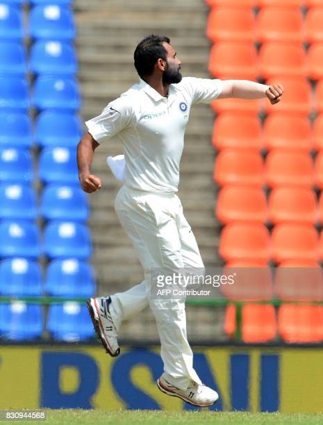 Indian cricketer Mohammed Shami celebrates after he dismissed Sri Lankan cricketer Dimuth Karunaratne during the second day of the third and final...