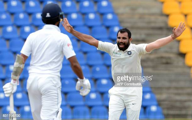 Indian cricketer Mohammed Shami celebrates after he dismissed Sri Lankan cricketer Kusal Mendis during the third day of the third and final Test...