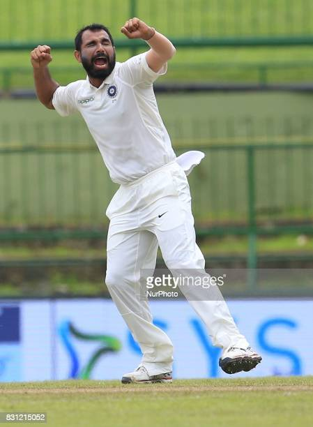 Indian cricketer Mohammed Shami celebrates after taking the wicket of Sri Lanka's Kusal Mendis during the 3rd Day's play in the 3rd and final Test...