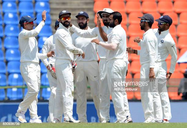 Indian cricketer Mohammed Shami celebrates with his teammates after he dismissed Sri Lankan cricketer Upul Tharanga during the second day of the...