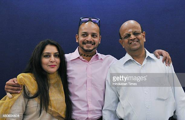 Indian Cricketer Murali Kartik with his father and wife Shweta after a press conference to announce his retirement from the Cricket on June 14 2014...