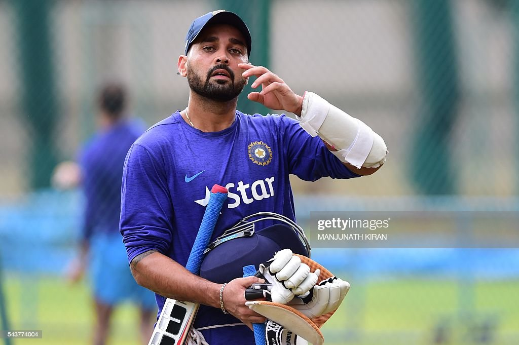 Indian cricketer Murali Vijay reacts after a net practice session at the National Cricket Academy (NCA)in Bangalore on June 30, 2016, where the Indian team is taking part in a preparatory camp ahead of their West Indies Test tour. / AFP / MANJUNATH