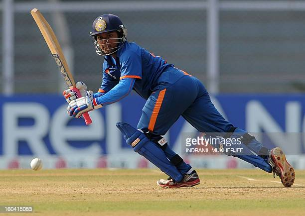 Indian cricketer Punam Raut plays a shot during the inugural match of the ICC Women's World Cup 2013 between India and West Indies at the Cricket...
