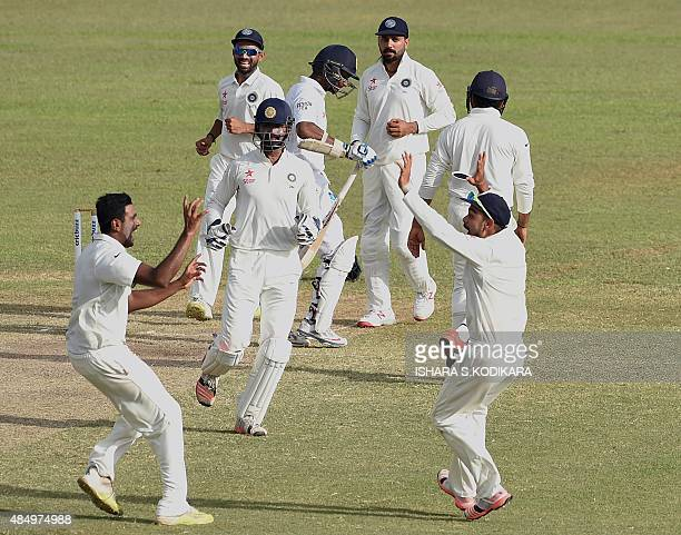 Indian cricketer Ravichandran Ashwin and teammates celebrate after dismissing Sri Lankan cricketer Kumar Sangakkara during the fourth day of the...