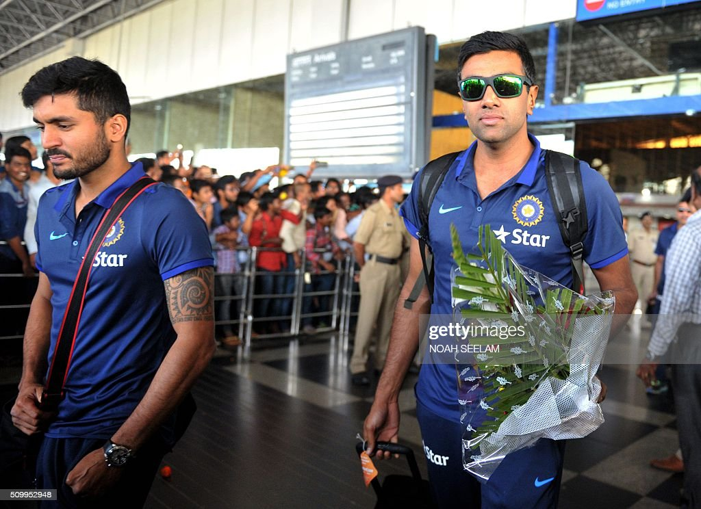 Indian cricketer Ravichandran Ashwin (R) arrives at the airport in Visakhapatnam on February 13, 2016.The third T20 international match between India and Sri Lanka will be played on February 14. AFP PHOTO / Noah SEELAM. ---- IMAGE RESTRICTED TO EDITORIAL USE - STRICTLY NO COMMERCIAL USE ---- / AFP / NOAH SEELAM