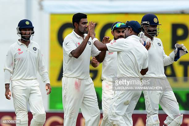 Indian cricketer Ravichandran Ashwin celebrates with his teammates after he dismissed Sri Lankan cricketer Dinesh Chandimal during the final day of...