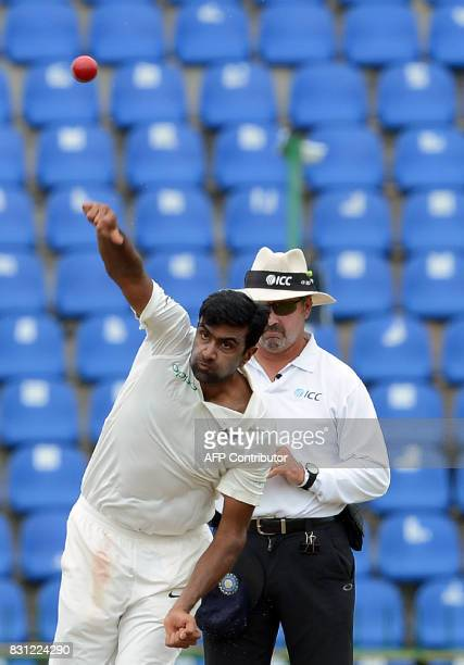 Indian cricketer Ravichandran Ashwin delivers the ball during the third day of the third and final Test match between Sri Lanka and India at the...