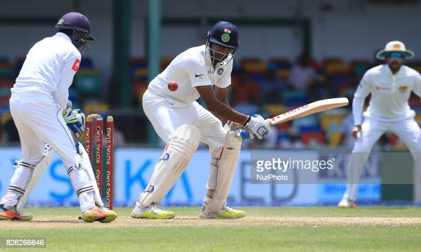 Indian cricketer Ravichandran Ashwin is bowled out as Sri Lankan wicket keeper Niroshan Dickwella looks on during the 2nd Day's play in the 2nd Test...