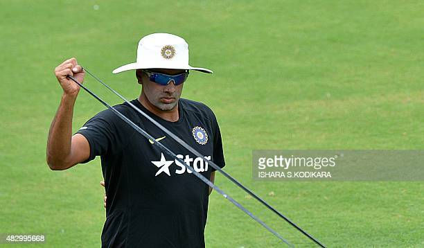 Indian cricketer Ravichandran Ashwin stretches during a practice session at the R Premadasa International Cricket Stadium in Colombo on August 5 2015...