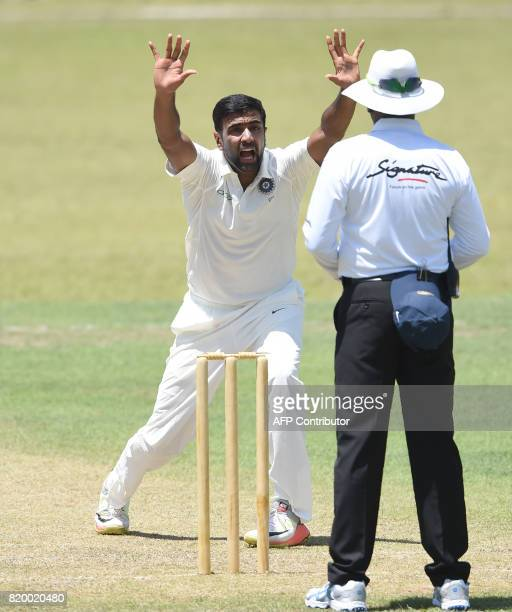 Indian cricketer Ravichandran Ashwin successfully appeals for a leg before wicket decision against Sri Lanka Board President's XI cricketer Danushka...