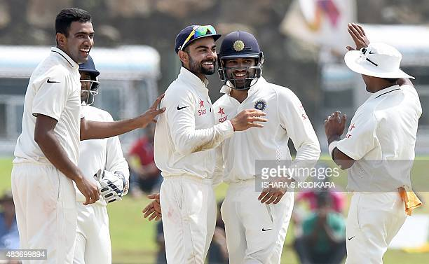 Indian cricketer Ravichandran Ashwin teammate Rohit Sharma and Indian cricket team captain Virat Kohli celebrate after dismissing unseen Sri Lankan...