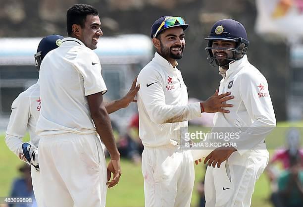 Indian cricketer Ravichandran Ashwin teammate Rohit Sharma and Indian cricket team captain Virat Kohli celebrate after the dismissal of unseen Sri...