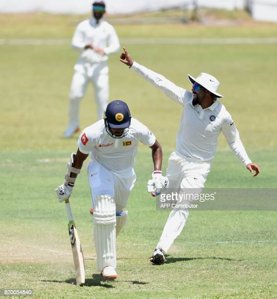 Indian cricketer Ravindra Jadeja celebrates after he dismissed Sri Lanka Board President's XI cricketer Danushka Gunathilaka during the first day of...
