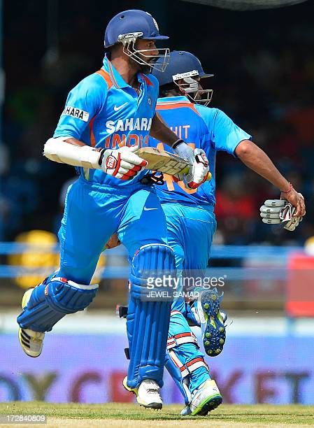 Indian cricketer Rohit Sharma and Shikhar Dhawan take a run during the fourth match of the TriNation series between India and West Indies at the...