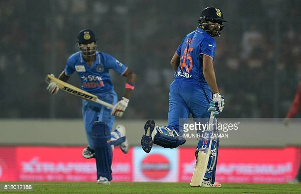 Indian cricketer Rohit Sharma and teammate Hardik Pandya run between the wickets during a Twenty20 cricket match between India and Bangladesh for the...