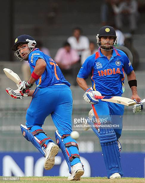 Indian cricketer Rohit Sharma and teammate Virat Kohli run between wickets during a World Twenty20 warmup match between India and Pakistan at The R...