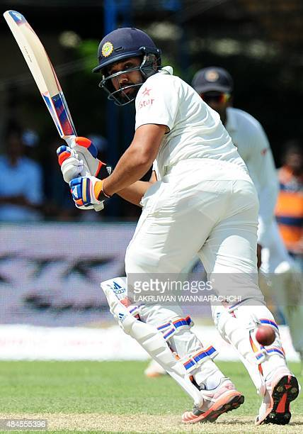 Indian cricketer Rohit Sharma looks back after hitting a ball to the boundary during the opening day of their second test match between Sri Lanka and...
