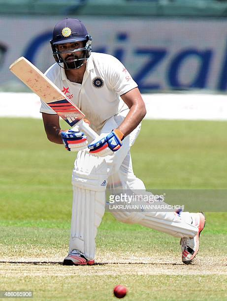 Indian cricketer Rohit Sharma plays a shot during the fourth day of the third and final Test match between Sri Lanka and India at the Sinhalese...