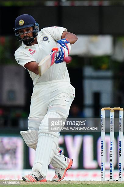 Indian cricketer Rohit Sharma plays a shot during the opening day of their second test match between Sri Lanka and India at the P Sara Oval Cricket...