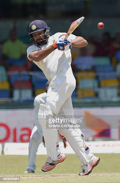 Indian cricketer Rohit Sharma plays a shot during the second day of the third and final Test cricket match between Sri Lanka and India at the...