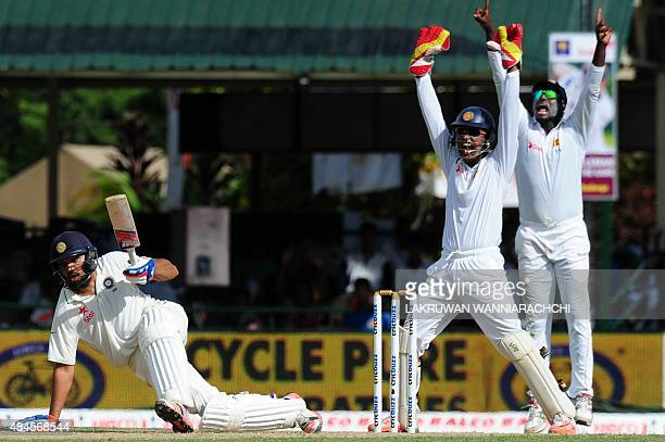 Indian cricketer Rohit Sharma reacts after Sri Lankan wicketkeeper Dinesh Chandimal and captain Angelo Mathews unsuccessfully appeal for a Leg Before...