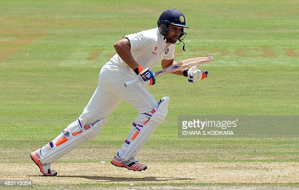 Indian cricketer Rohit Sharma runs between the wickets during the first day of the threeday warmup match between Sri Lanka Board President's XI and...