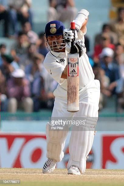 Indian Cricketer Sacchin Tendulkar bats during day five of the First Test match between India and Australia at Punjab Cricket Association Stadium on...