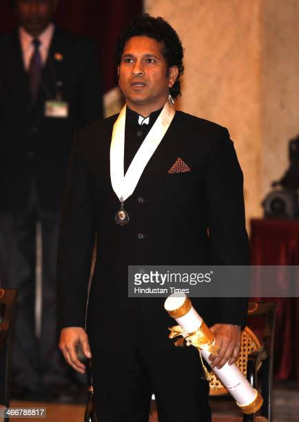 Indian cricketer Sachin Tendulakr sung the National Anthem after receiving the Bharat Ratna award from Indian President Pranab Mukherjee during an...