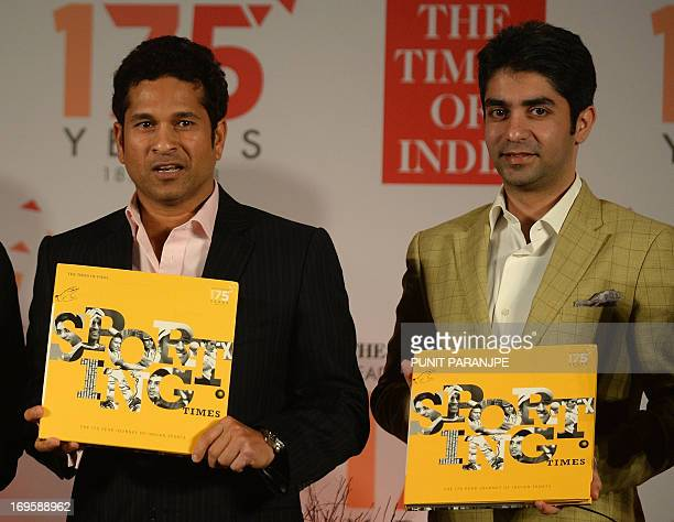Indian cricketer Sachin Tendulkar and the Beijing Olympics gold medallist shooter Abhinav Bindra hold copies of the new book 'Sporting Times' during...