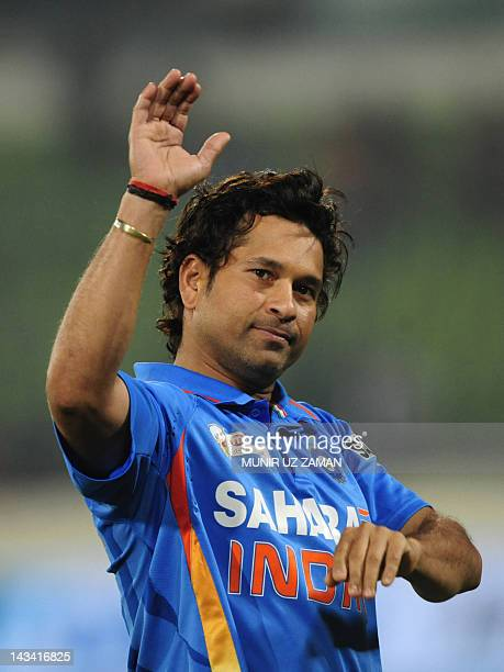 Indian cricketer Sachin Tendulkar gestures after India's win at the one day international Asia Cup cricket match against Pakistan at The ShereBangla...