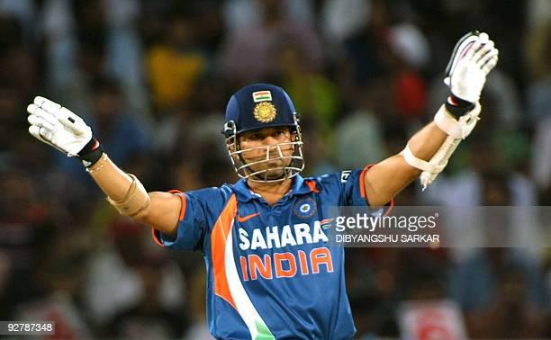 Indian cricketer Sachin Tendulkar gestures during the fifth OneDay International between India and Australia at the Rajiv Gandhi International...
