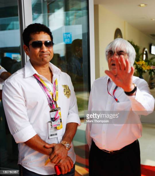 Indian cricketer Sachin Tendulkar meets F1 supremo Bernie Ecclestone in the paddock before the Indian Formula One Grand Prix at the Buddh...