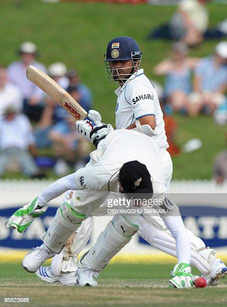 Indian cricketer Sachin Tendulkar plays a shot as New Zealand wicket keepet Drendon McCullum attempts to stop the ball during the third day of the...