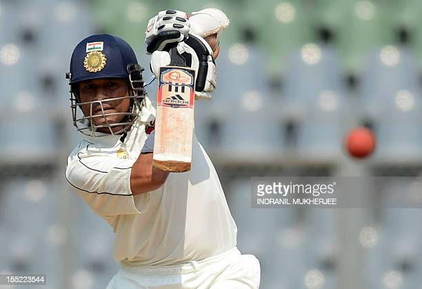 Indian cricketer Sachin Tendulkar plays a shot while batting for his state team during the Ranji Trophy match between Mumbai and Railways at the...