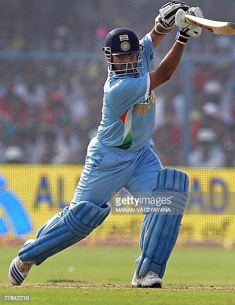 Indian cricketer Sachin Tendulkar plays a stroke during the third Oneday International match against Pakistan at the Green Park Stadium in Kanpur 11...