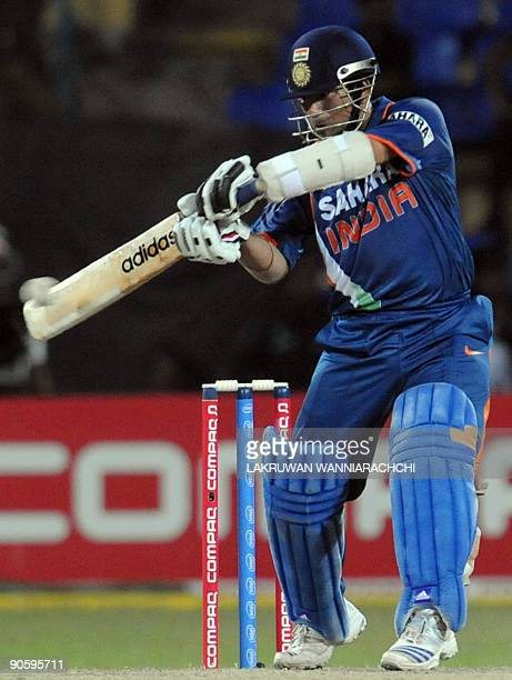 Indian cricketer Sachin Tendulkar plays a stroke during the TriNation Championship trophy second One Day International match between India and New...