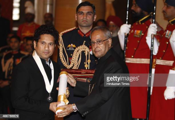 Indian cricketer Sachin Tendulkar receives the Bharat Ratna award from Indian President Pranab Mukherjee during an awards ceremony at the...