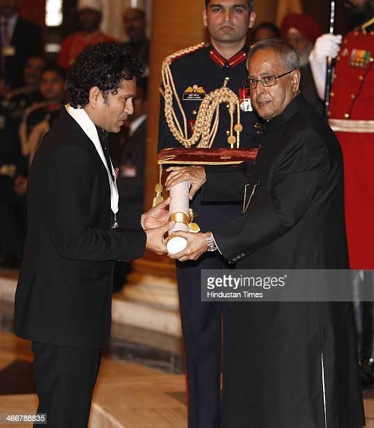 Indian cricketer Sachin Tendulkar receives the Bharat Ratna award from Indian President Pranab Mukherjee during an awards ceremony at the...