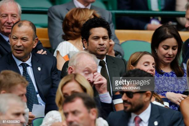 Indian cricketer Sachin Tendulkar sits in the Royal box on Centre Court for the men's semifinal matches on the eleventh day of the 2017 Wimbledon...