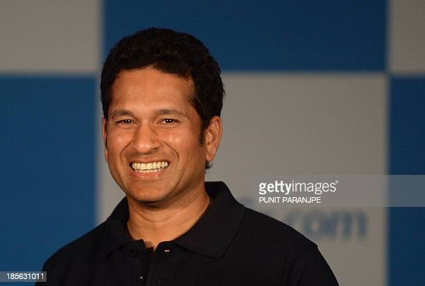 Indian cricketer Sachin Tendulkar smiles during a news conference to launch a new travel portal in Mumbai on October 23 2013 Legendary Indian batsman...